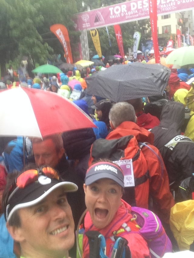 At the starting line with Jess, and some umbrellas.
